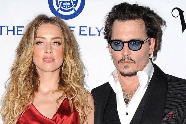 PAY-Amber-Heard-and-Johnny-Depp